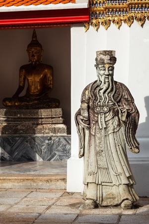 Wat Pho Chinese stone guardian, Bangkok, Thailand photo