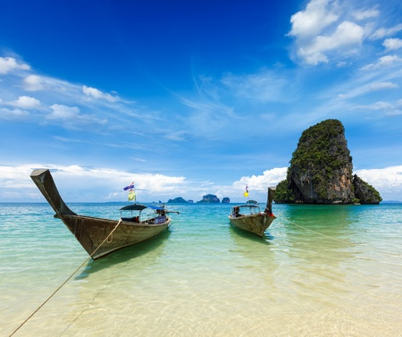 travelled: Long tail boats on tropical idyllic beach (Pranang beach), Krabi, Thailand Stock Photo