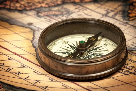 map compass: Old vintage retro compass on ancient map