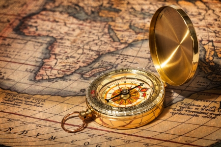 map compass: Old vintage retro golden compass on ancient map