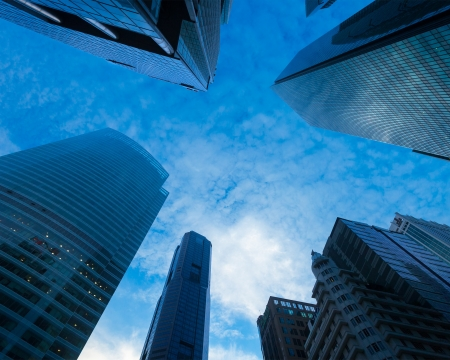 Urban buildings skyscrapers in sky on dusk background photo