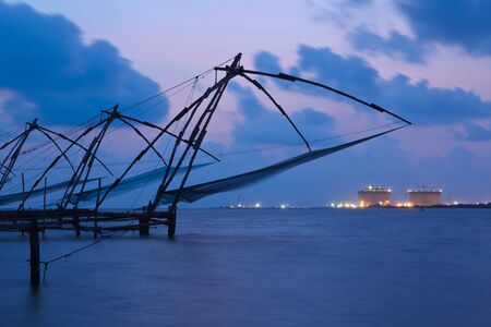 fishnets: Kochi chinese fishnets in twilight. Fort Kochin, Kochi, Kerala, India Stock Photo