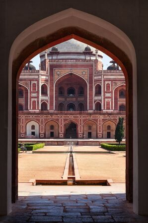 north gate: Humayuns Tomb. View through arch. Delhi, India Editorial