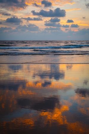 Sunset on Baga beach. Goa, India photo