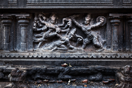 Bas relief depicting Durga slaying demon (Maheeshasuramardini). Brihadishwara Temple. Tanjore (Thanjavur), Tamil Nadu, India. The Greatest of Great Living Chola Temples