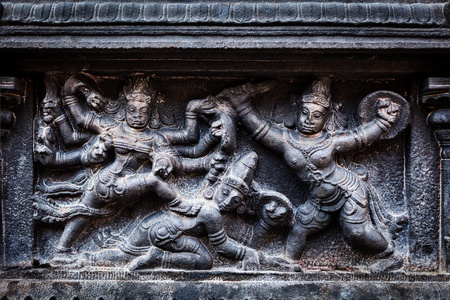 bas: Bas relief depicting Durga slaying demon (Maheeshasuramardini). Brihadishwara Temple. Tanjore (Thanjavur), Tamil Nadu, India. The Greatest of Great Living Chola Temples