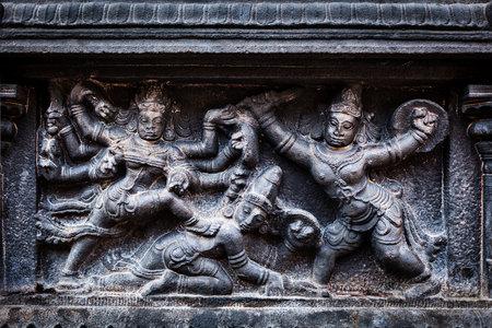 slaying: Bas relief depicting Durga slaying demon (Maheeshasuramardini). Brihadishwara Temple. Tanjore (Thanjavur), Tamil Nadu, India. The Greatest of Great Living Chola Temples