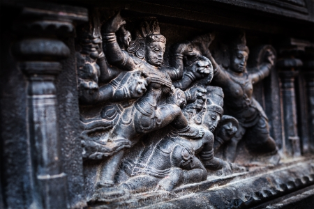 Bas relief depicting Durga slaying demon (Maheeshasuramardini). Brihadishwara Temple. Tanjore (Thanjavur), Tamil Nadu, India. The Greatest of Great Living Chola Temples  photo
