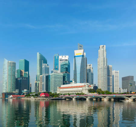 Singapore business district skyscrapers and Marina Bay in day
