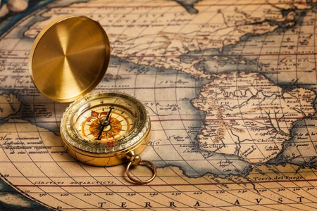 navigational: Old vintage retro golden compass on ancient map