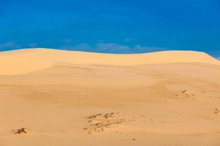 White sand dunes on sunrise, Mui Ne, Vietnam Stock Photo - 15446311