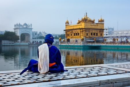 amritsar: Unidentifiable Seekh Nihang warrior meditating at Sikh temple Harmandir Sahib. Amritsar, India