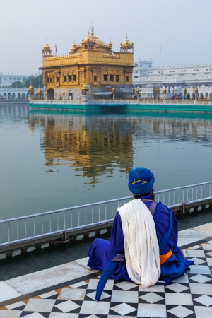 Unidentifiable Seekh Nihang warrior meditating at Sikh temple Harmandir Sahib. Amritsar, India photo