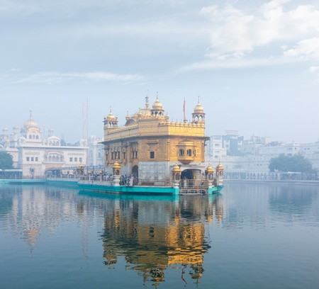 Sikh gurdwara Golden Temple (Harmandir Sahib) in morning fog. Amritsar, Punjab, India photo