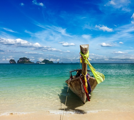 Long tail boat on tropical beach, Krabi, Thailand photo