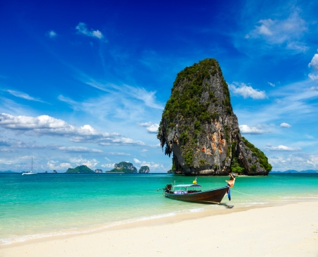 Long tail boat on tropical beach with limestone rock, Krabi, Thailand Stock Photo - 16185895