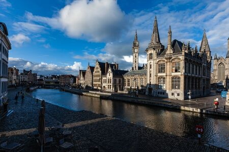 Ghent canal and Graslei street on sunset. Ghent, Belgium photo