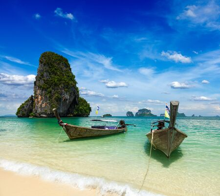 Long tail boats on tropical beach, Krabi, Thailand photo