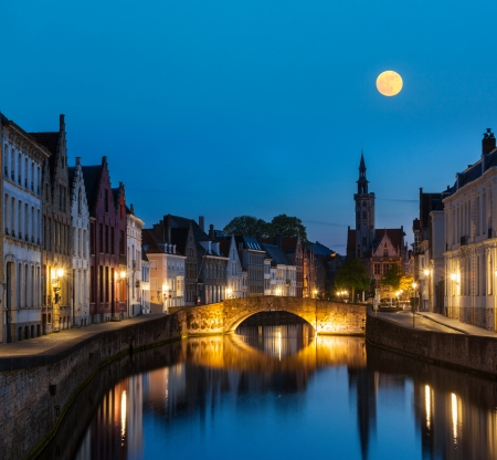 brugge: European medieval night city view background - Bruges (Brugge) canal in the evening, Belgium