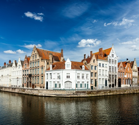 brugge: Benelux Travel  concept background - Bruges canal and medieval houses. Brugge, Belgium Stock Photo