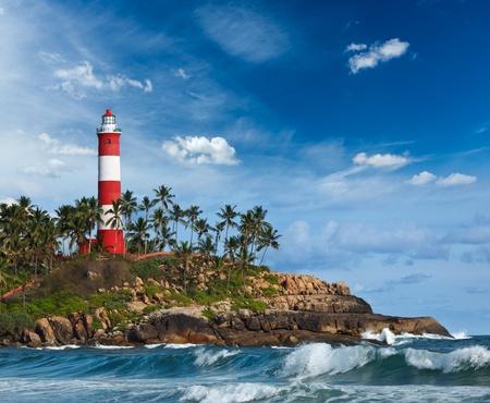 kovalam: Old lighthouse and waves of  sea. Kovalam (Vizhinjam) Kerala, India Stock Photo