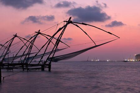 Kochi chinese fishnets on sunset. Fort Kochin, Kochi, Kerala, India Stock Photo - 18541408