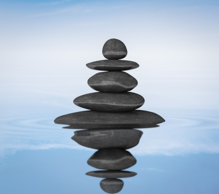 stack rock: Zen stones in water with reflection balance concept Stock Photo