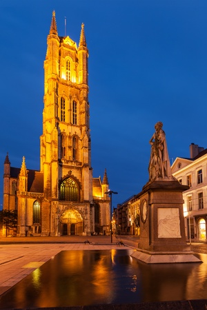 frans: Monument to Jan Frans Willems and Saint Bavo Cathedral in the evening. Sint-Baafsplein, Flanders, Ghent, Belgium Stock Photo