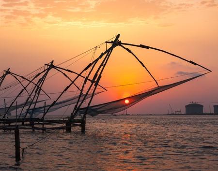 Kochi chinese fishnets on sunset  Fort Kochin, Kochi, Kerala, India photo