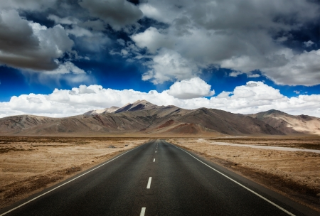 plains indian: Travel forward concept background - road on plains in Himalayas with mountains and dramatic clouds  Manali-Leh road, Ladakh, Jammu and Kashmir, India