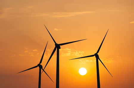 wind energy: Green renewable energy concept - wind generator turbines in sky on sunset