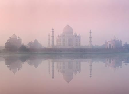 taj: Taj Mahal on sunrise sunset reflection in Yamuna river panorama in fog, Indian Symbol - India travel background. Agra, Uttar Pradesh, India