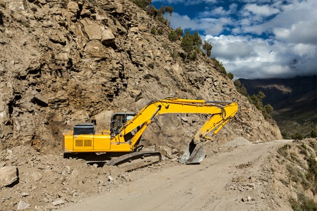 earthroad: Road construction in mountains Himalayas - excavator. Lahaul valley, Himachal Pradesh, India