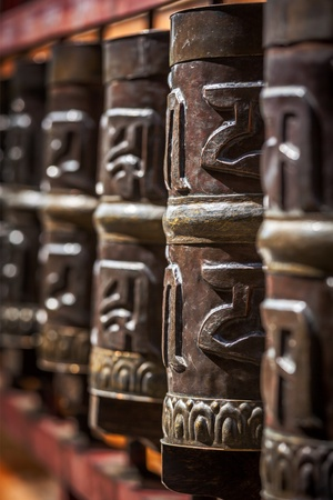 Tibetan Buddhist prayer wheels in Buddhism temple. Shallow depth of field. Rewalsar, HImachal Pradesh, India photo