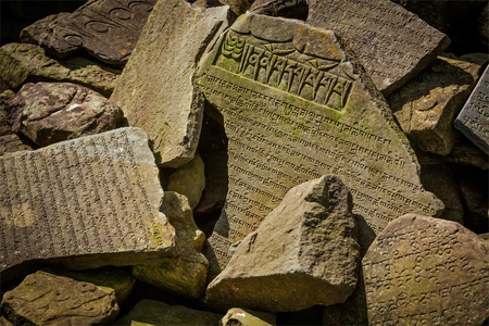 Buddhist prayer mantras on stones in Tibetan Buddhism temple photo