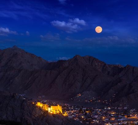 ladakh: Night view of Leh city, Leh palace and Himalayas. Ladakh, Jammu and Kashmir, India Stock Photo