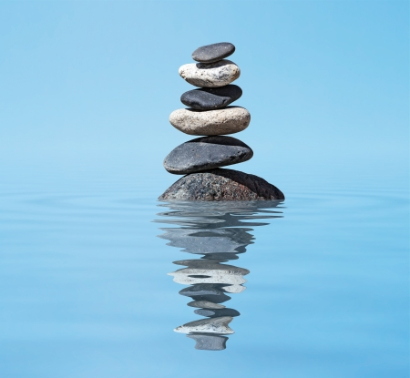 stack rock: Zen meditation background -  balanced stones stack in water with reflection