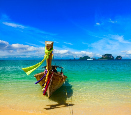 longtail: Long tail boat on tropical beach, Krabi, Thailand Stock Photo