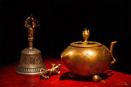 Tibetan Buddhist still life - vajra, bell, water vessel. Hemis gompa, Ladakh, India. photo