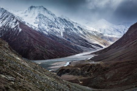 rigorous: Severe mountains - Spiti valley, river, road in Himalayas. Himachal Pradesh, India