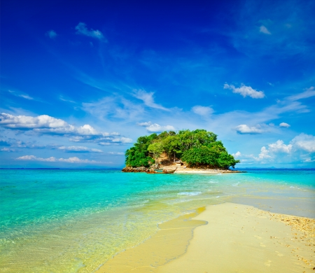 Vacation holidays concept background - tropical island and long-tail boat in sea. Thailand photo