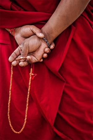 prayers: Tibetan Buddhism - prayer beads in Buddhist monk hands. Ladakh, India