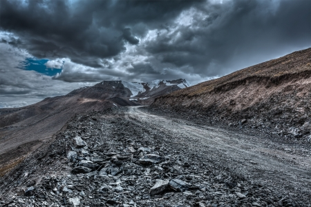 cloudiness: Road in Himalayas near Tanglang la Pass  - Himalayan mountain pass on the Leh-Manali highway in stormy weather. Ladakh, India