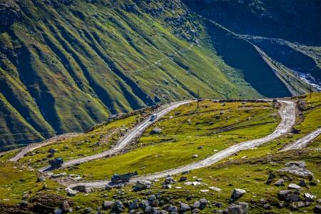unsurfaced road: Road in Himalayas. Rohtang La pass, Lahaul valley, Himachal Pradesh, India Stock Photo