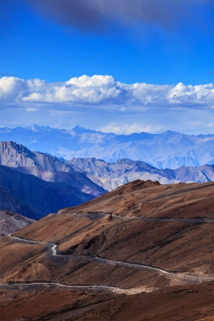 unsurfaced road: Road in Himalayas near Tanglang la Pass  - Himalayan mountain pass on the Leh-Manali highway. Ladakh, India Stock Photo