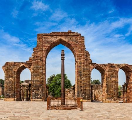 worn structure: Iron pillar in Qutub complex - metallurgical curiosity.  Qutub Complex, Delhi, India