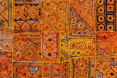 Colorful indian fabric textile texture background patchwork carpet quilt. India photo
