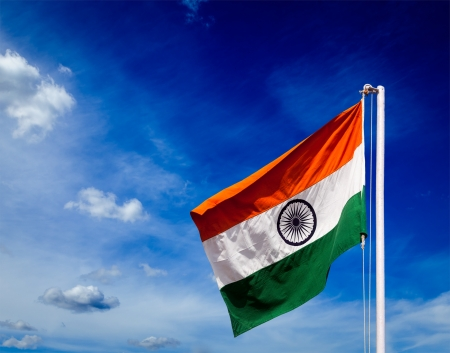 India indian flag in blue sky - copyspace Фото со стока