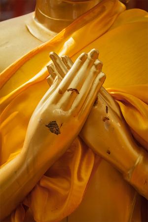 Buddha statue hands in  Vajrapradama Mudra (Mudra of Unshakable Self Confidence). Wat Phra That Doi Suthep, Chiang Mai, Thailand photo
