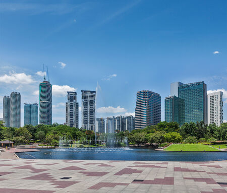 city park fountain: Skyline of Central Business District of Kuala Lumpur, Malaysia Stock Photo